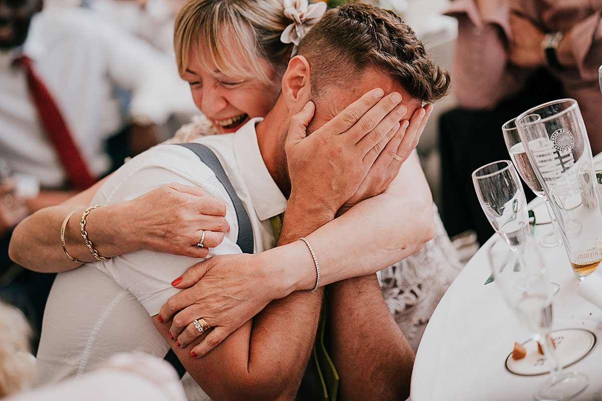 Al's mum embraces his son during the speeches at Lusty Glaze