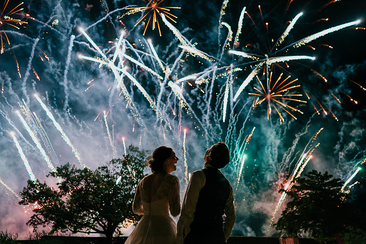 documentary wedding photographer - image of bride and groom with fireworks